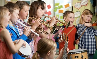 Group music lessons and classes encourage collaboration while also teaching children to appreciate their individual part in a larger ensemble