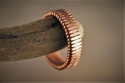 Hammered string ring