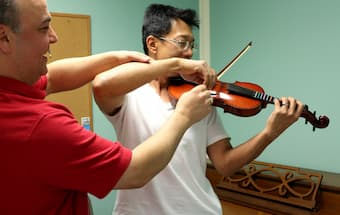 Addressing back pain for violinist