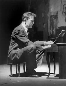 John Cage performing at the toy piano