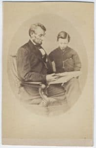 Matthew Brady, Lincoln Reading to his Son Tad, 1864