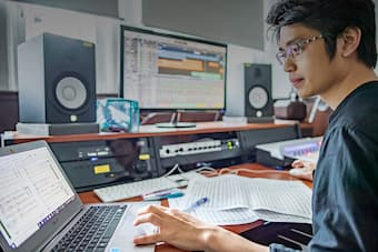 music student composing with computer