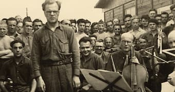 A prisoner orchestra at Stalag VIII-A in Goerlitz, Silesia (now Germany), with Ferdinand Carrion, a Belgian musician and prisoner-of-war, conducting.